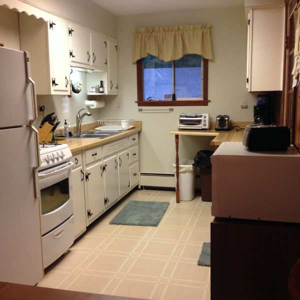 Clean kitchen with microwave and many appliances